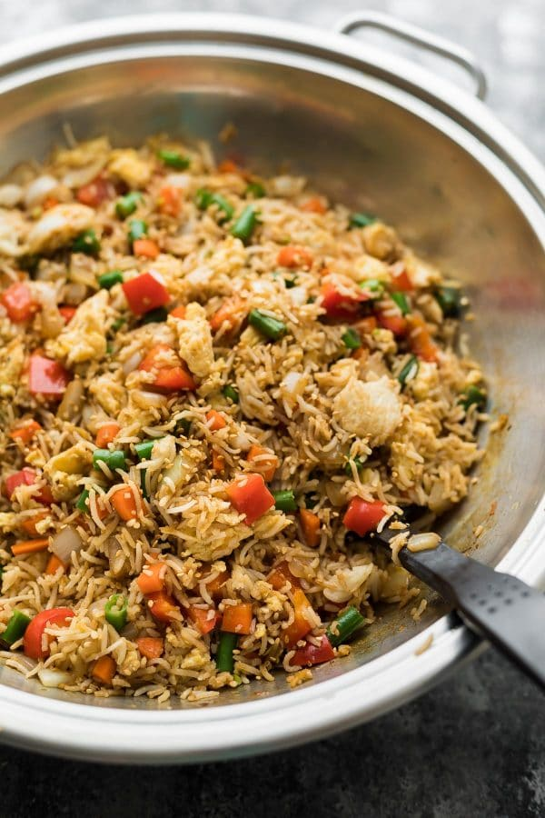 Fried rice with a large wok with spatula