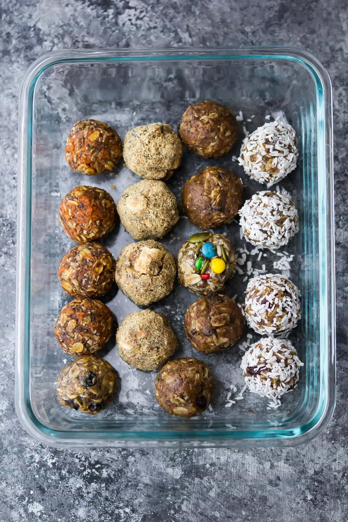 Types of energy bites in the oven in a food preparation container