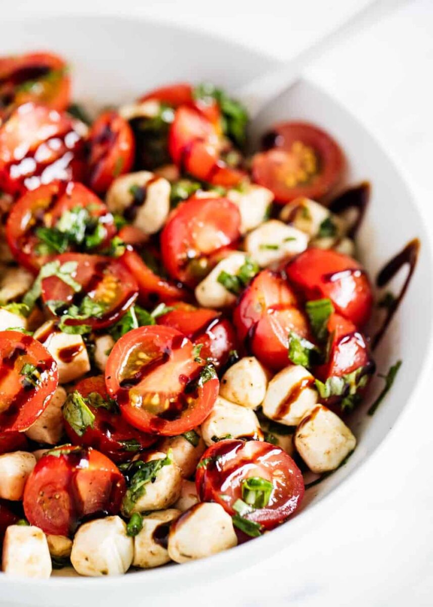 tomato basil mozzarella salad in white bowl