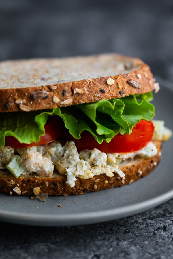 close up view of chickpea salad sandwich on plate
