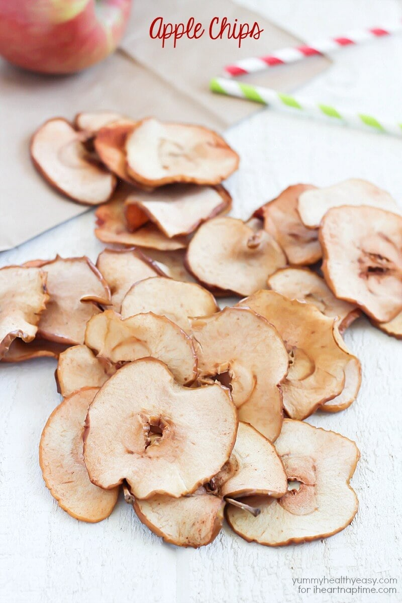 homemade apple chips spread out on a table
