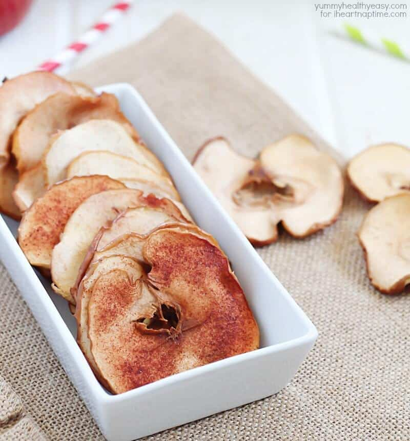 baked cinnamon apple chips in a white bowl