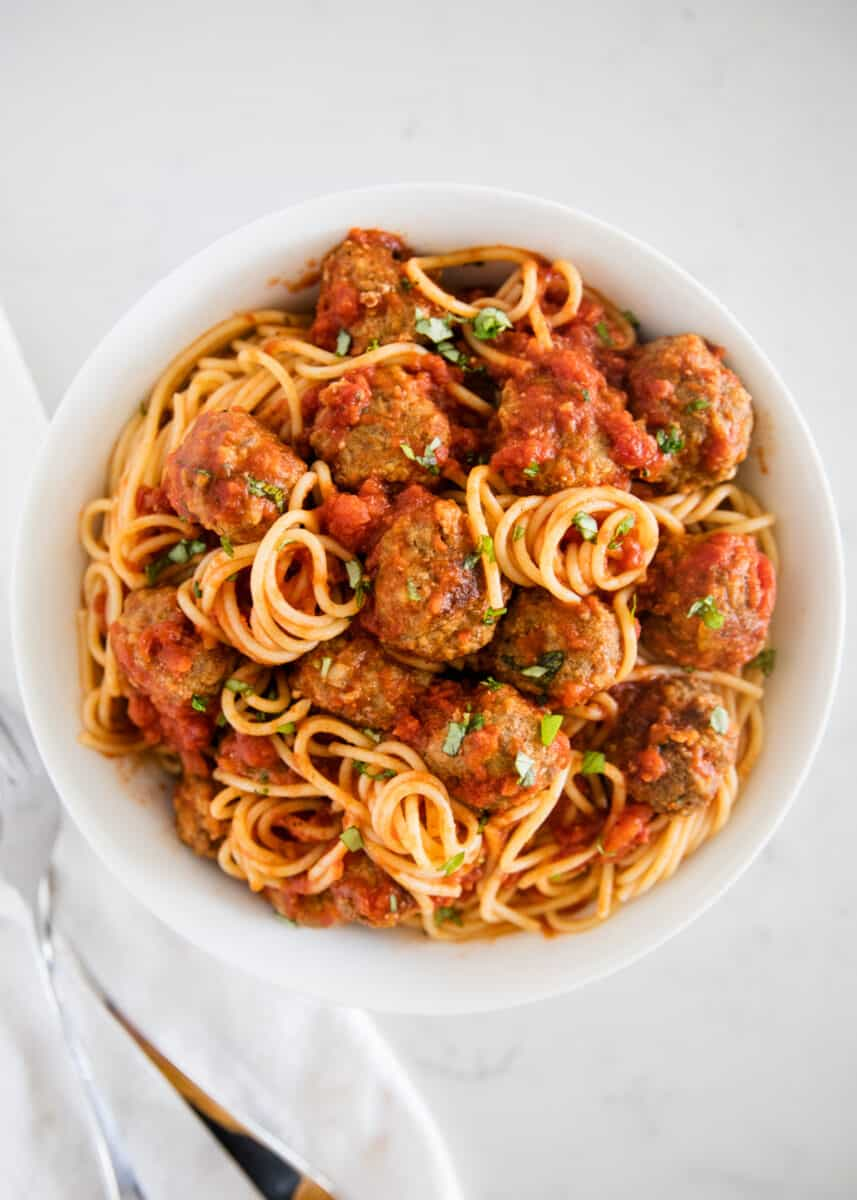 spaghetti and meatballs on white plate