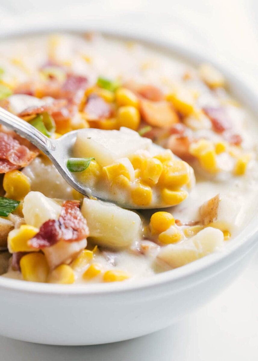 bowl of corn chowder with spoon
