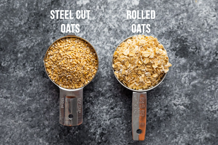 measuring cups with rolled oats and steel cut oats side by side