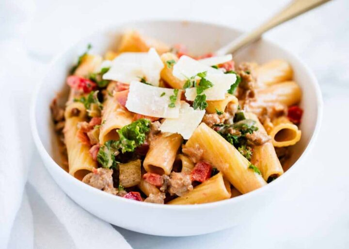 rigatoni noodles with bolognese sauce in white bowl