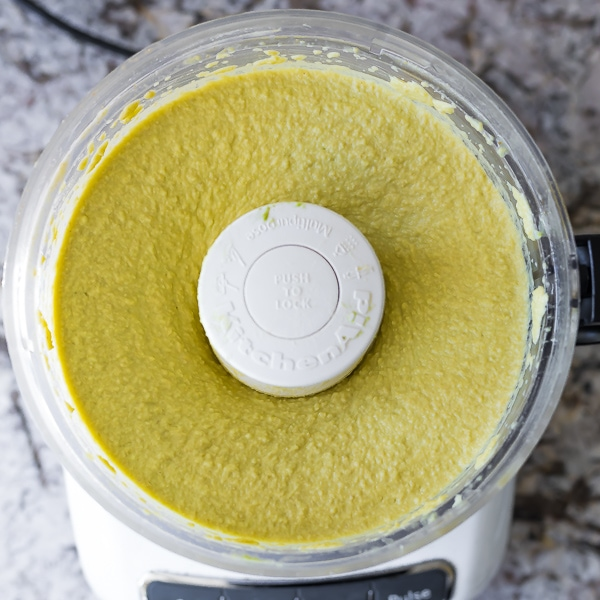 ingredients for Creamy Avocado Hummus recipe in food processor (after processing)