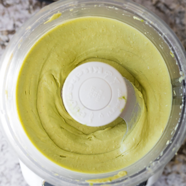 ingredients for Creamy Avocado Hummus in food processor (after processing)
