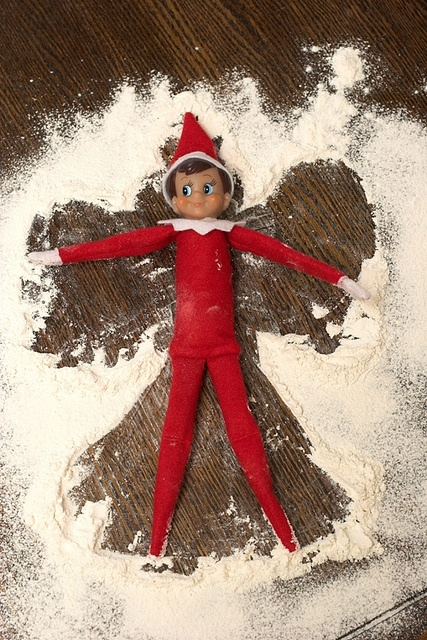 Snow angel elf on the shelf in the kitchen with flour