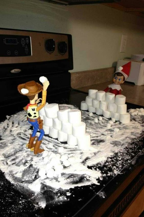 Funny elf on the shelf ideas in the kitchen with other toys