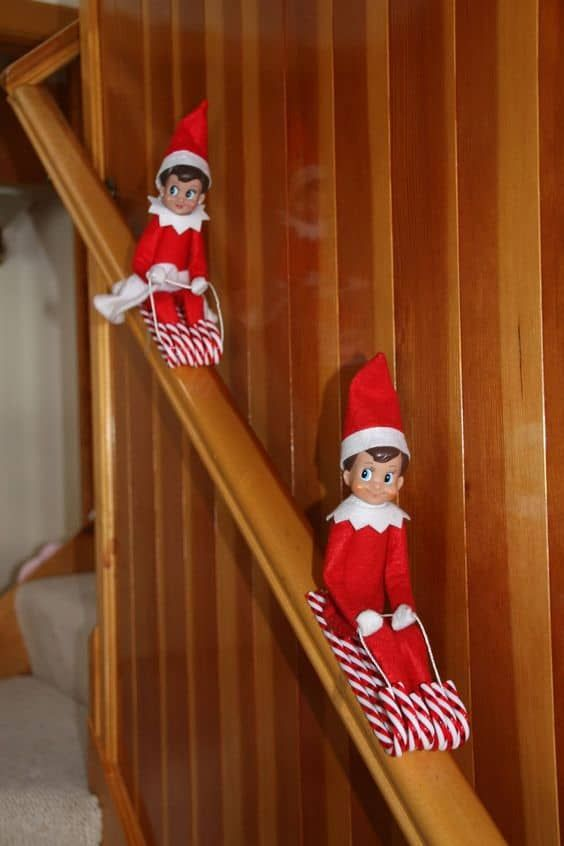 Cute elf on the shelf on candy cane sleighs