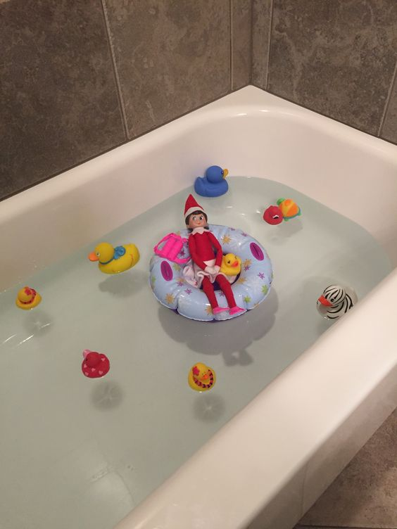 Cute elf on the shelf ideas in the bathroom - elf having a bath
