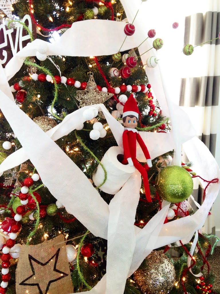 Naughty elf on the shelf pictures with toilet paper on a Christmas tree