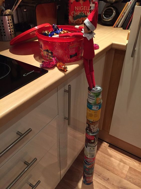 Naughty elf on the shelf ideas in the kitchen