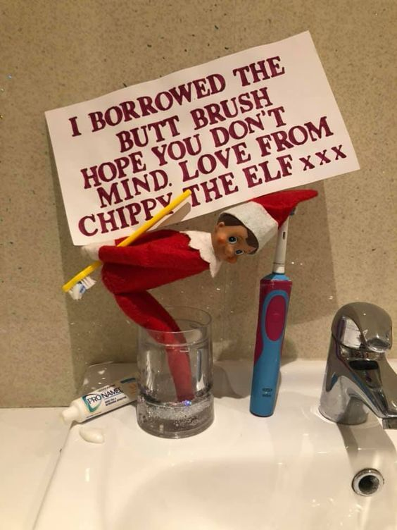 Naughty elf on the shelf ideas with toothbrush in the bathroom