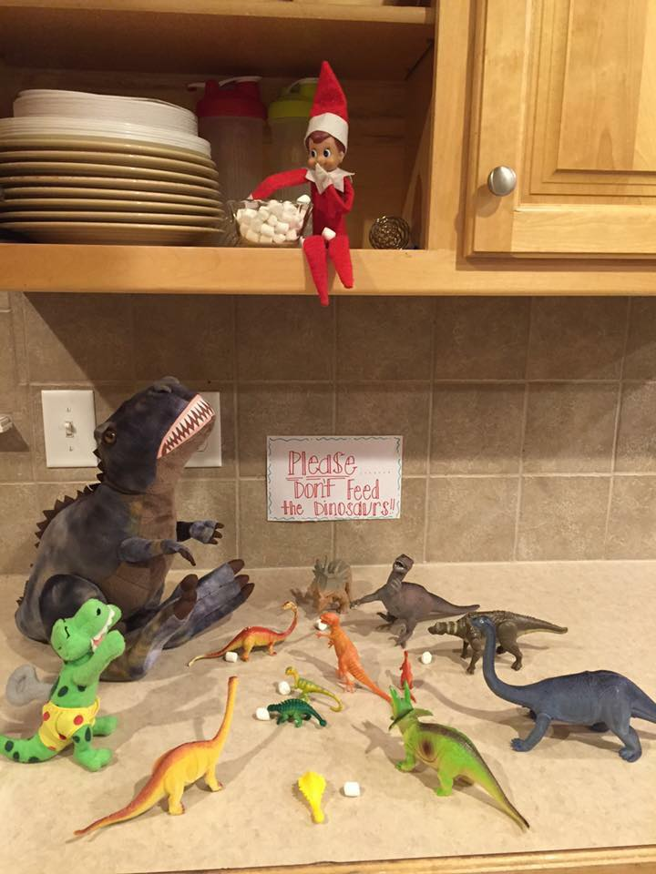 Elf on the shelf funny pictures with dinosaur toys