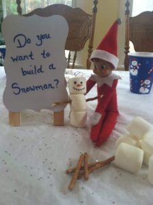 Elf on the shelf building a snowman