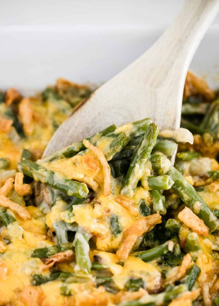 green bean casserole served with wooden spoon