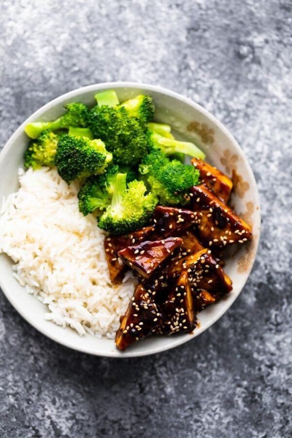 Top view of teriyaki tofu in bowl with rice and broccoli