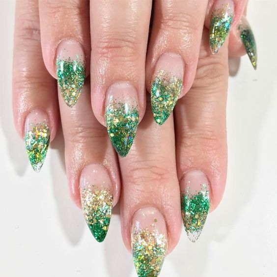 Green almond shape ombre nails, cute St Patrick & # 39; s Day nails with glitter
