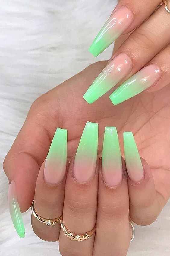 Light green ombre nails in a coffin shape