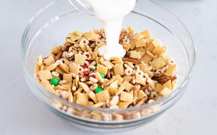 Chex Mix, pretzels, Cheerios and M & Ms in the bowl