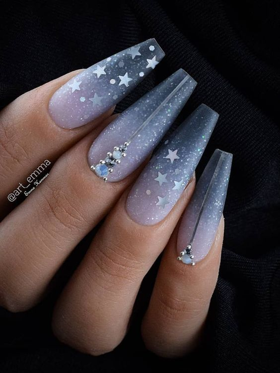 Dark blue ombre nail coffin with stars