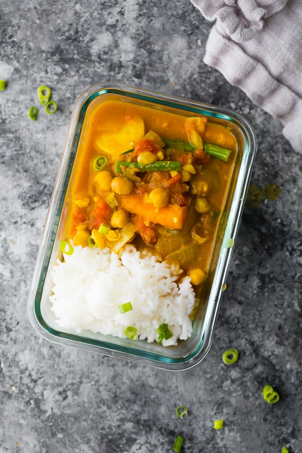 Chickpea and coconut curry in a bowl with rice.