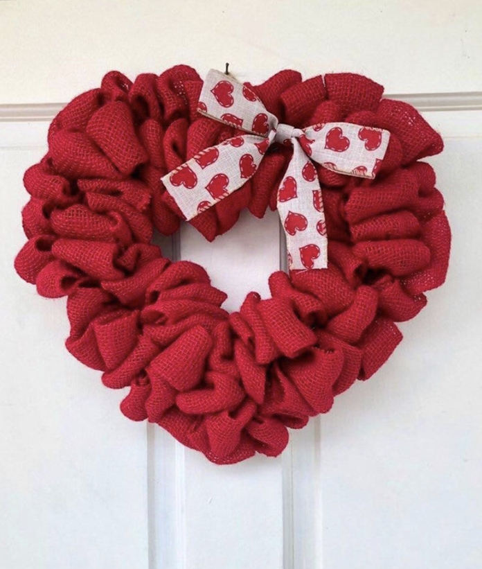 Heart-shaped wreath made of red burlap