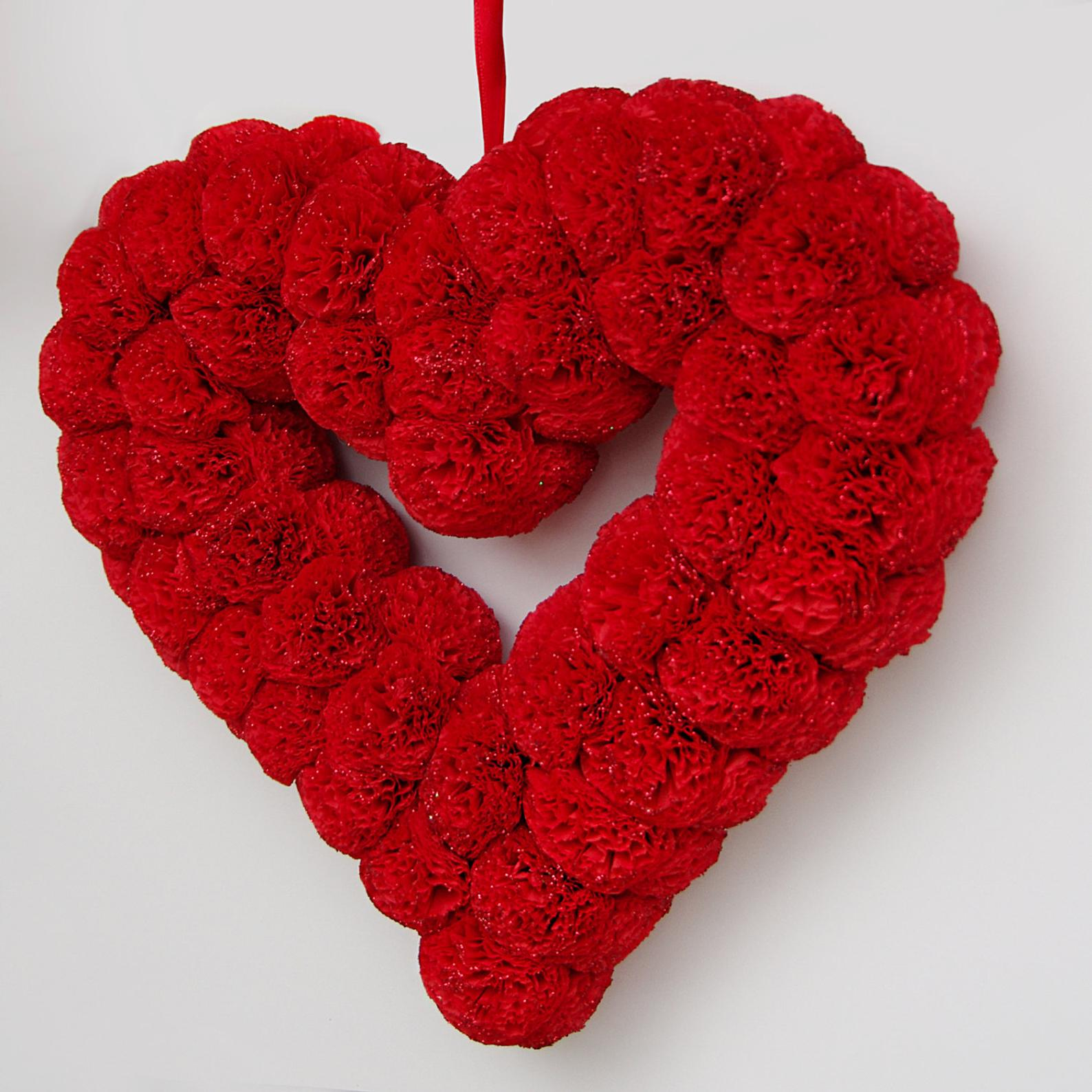 Red heart-shaped wreath for Valentine's Day