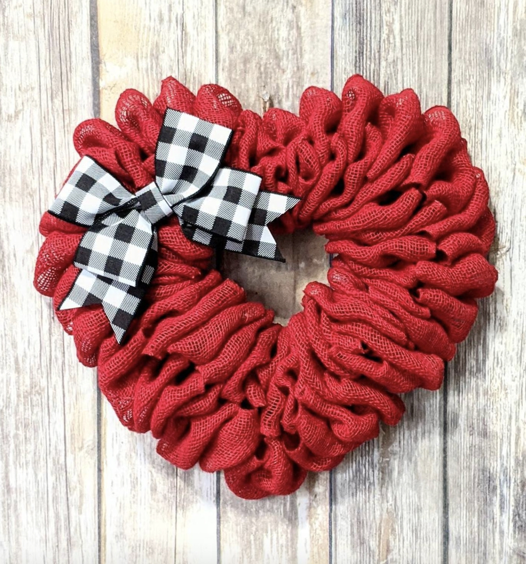 Heart-shaped wreath made of red burlap with a buffalo plaid