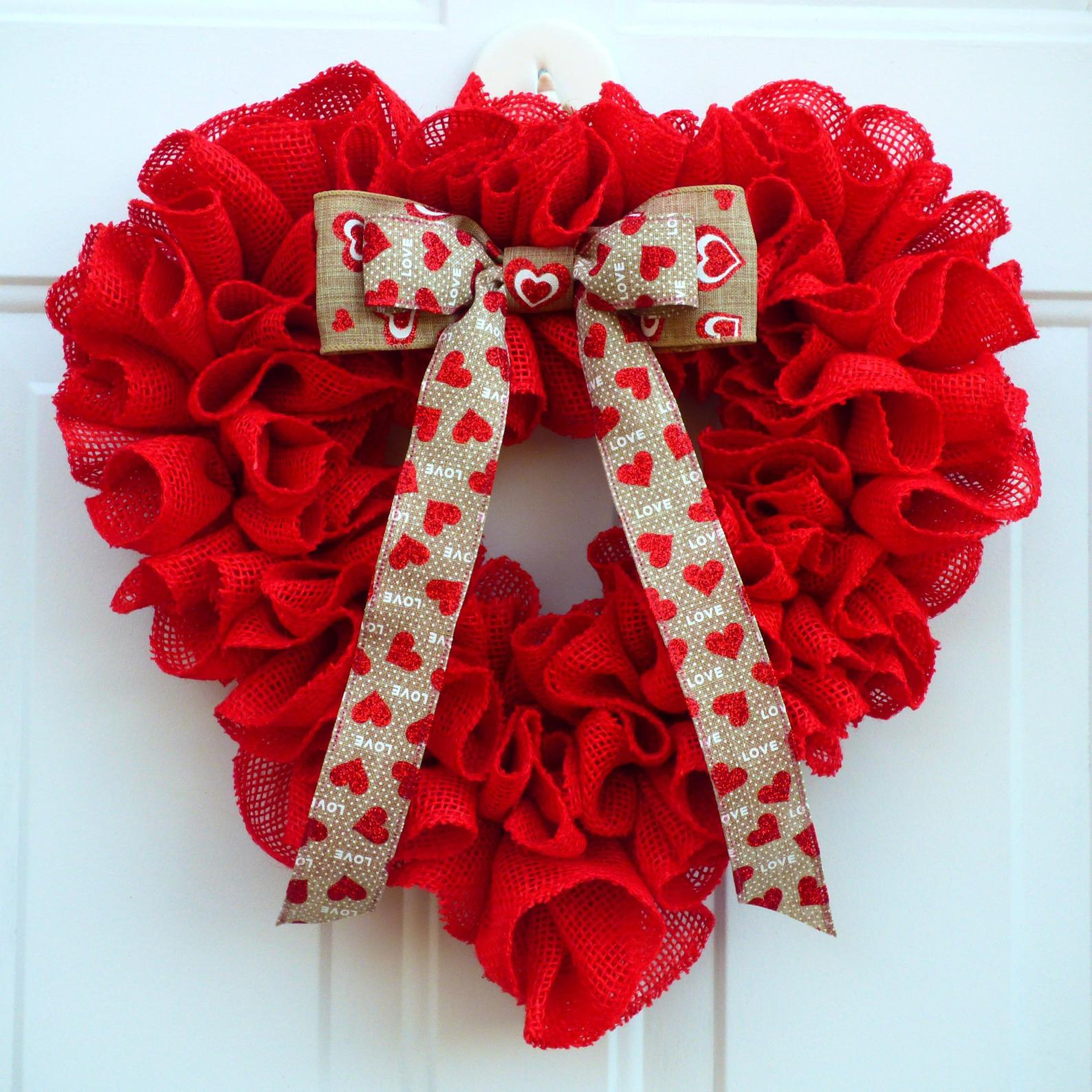 Red heart-shaped wreath with burlap