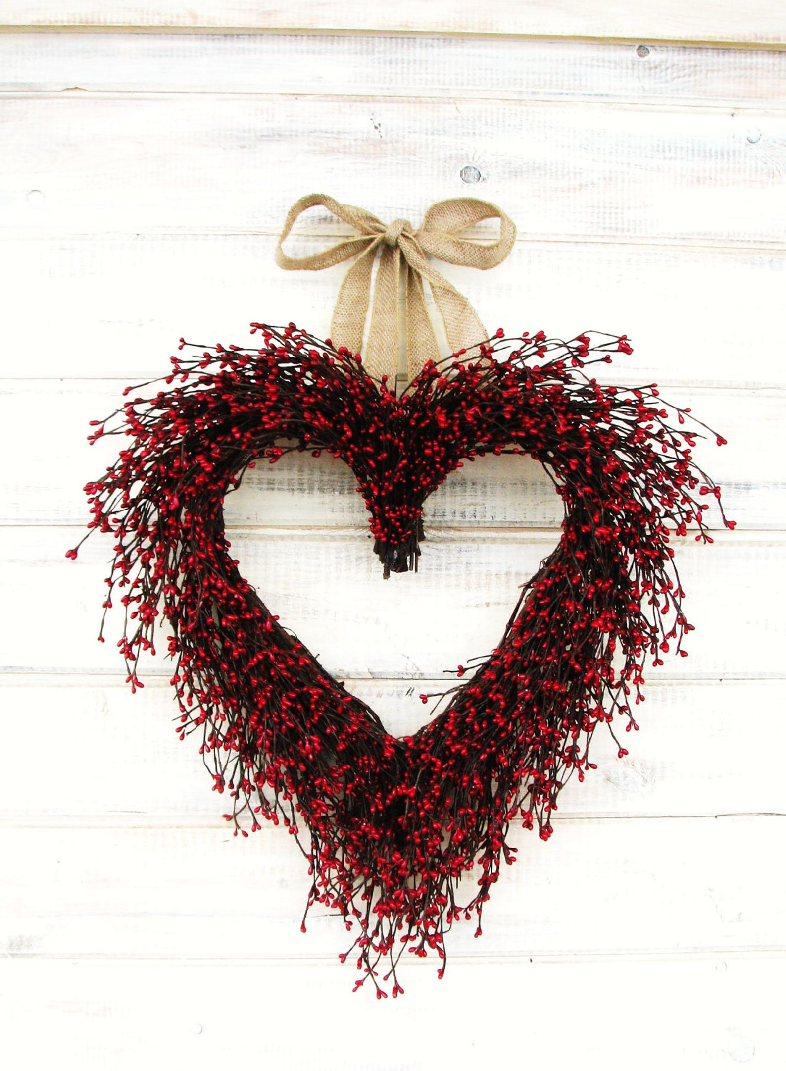 Red heart-shaped wreath with strawberries