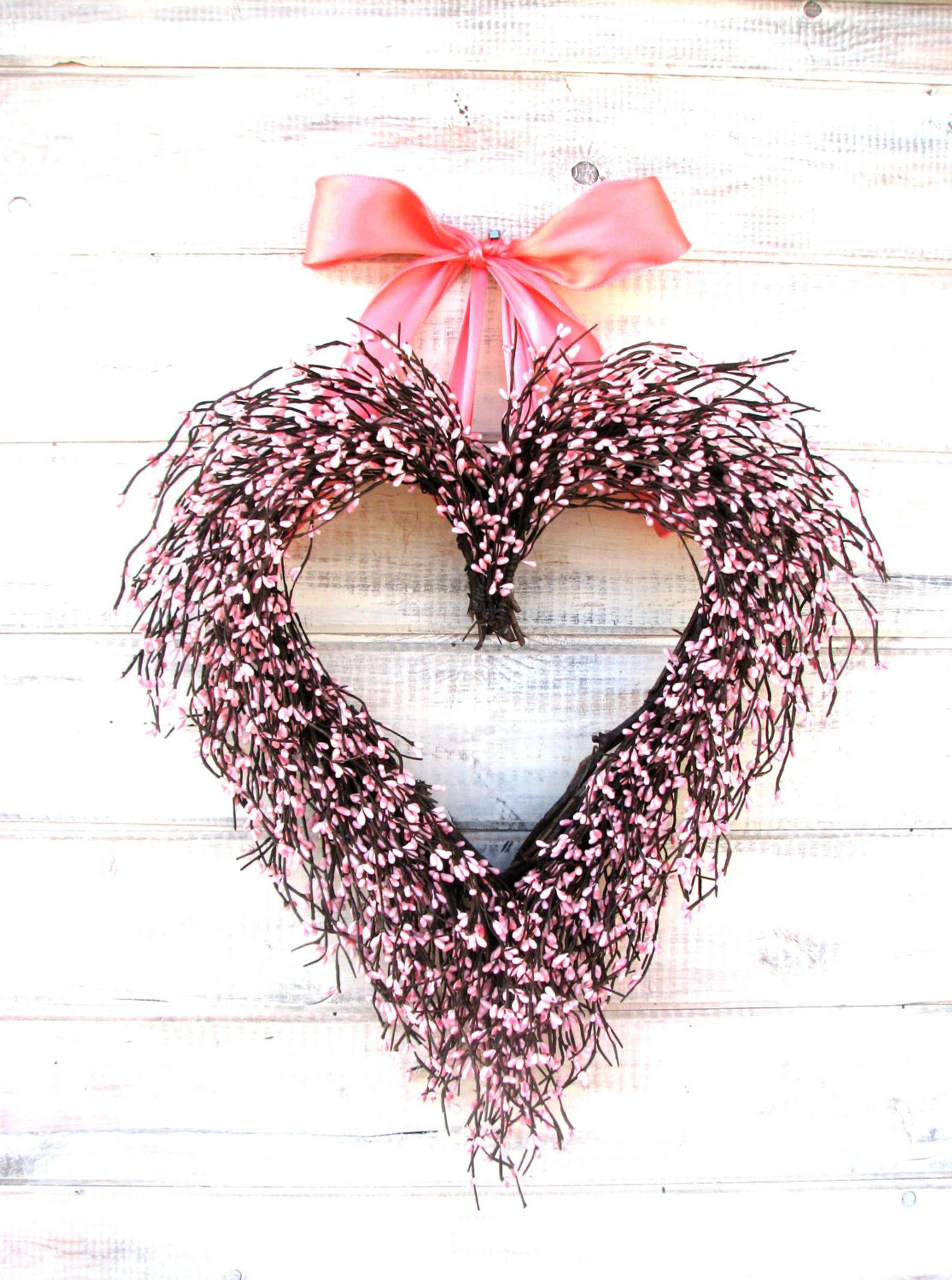 Pink heart-shaped wreath with strawberries