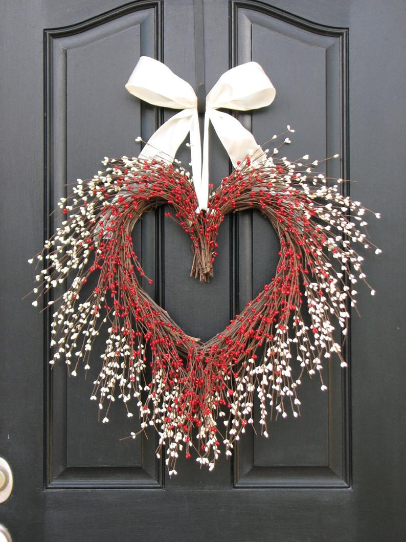 White and red heart-shaped wreath with strawberries