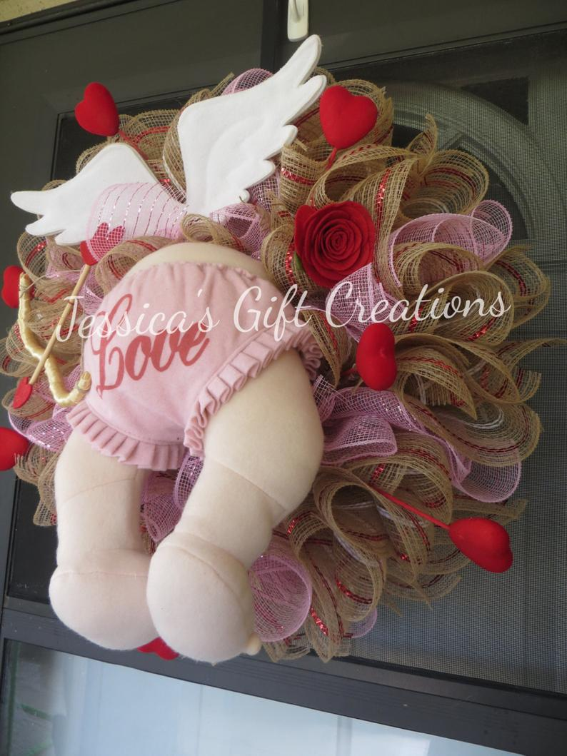 Cute decorative knitted Valentine's wreath with Cupid