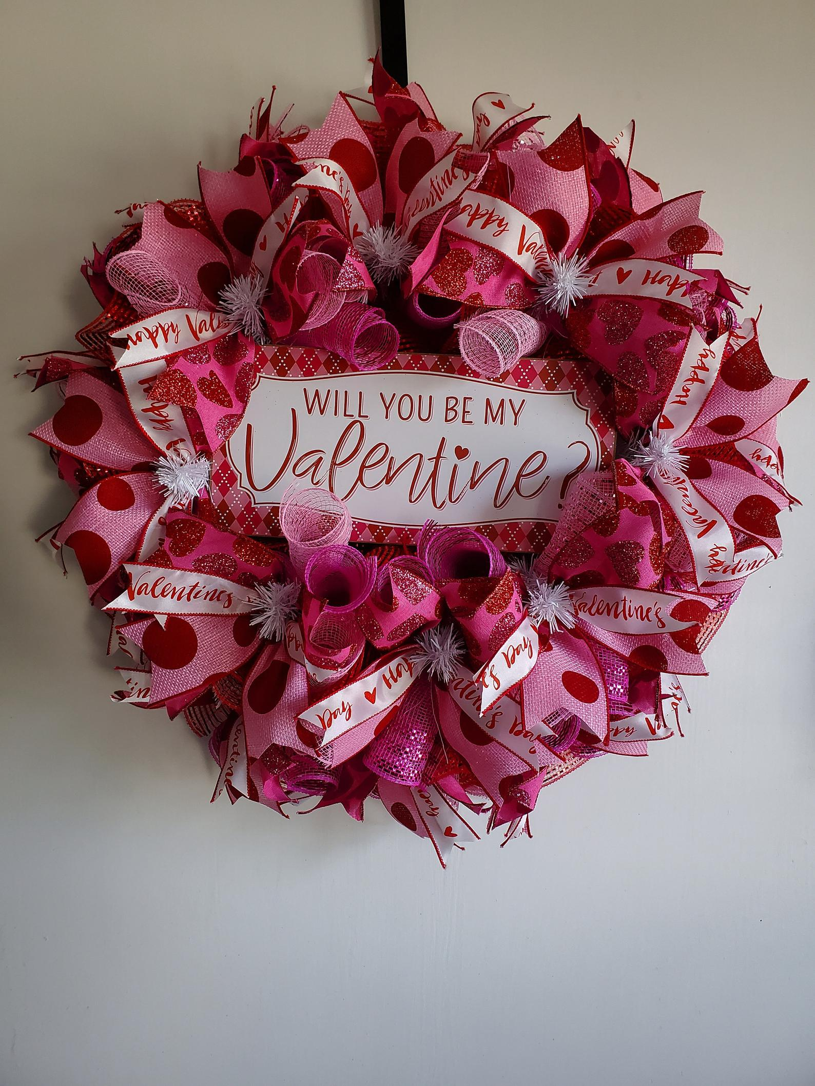 Pink decorative knitted Valentine's wreaths for the front door
