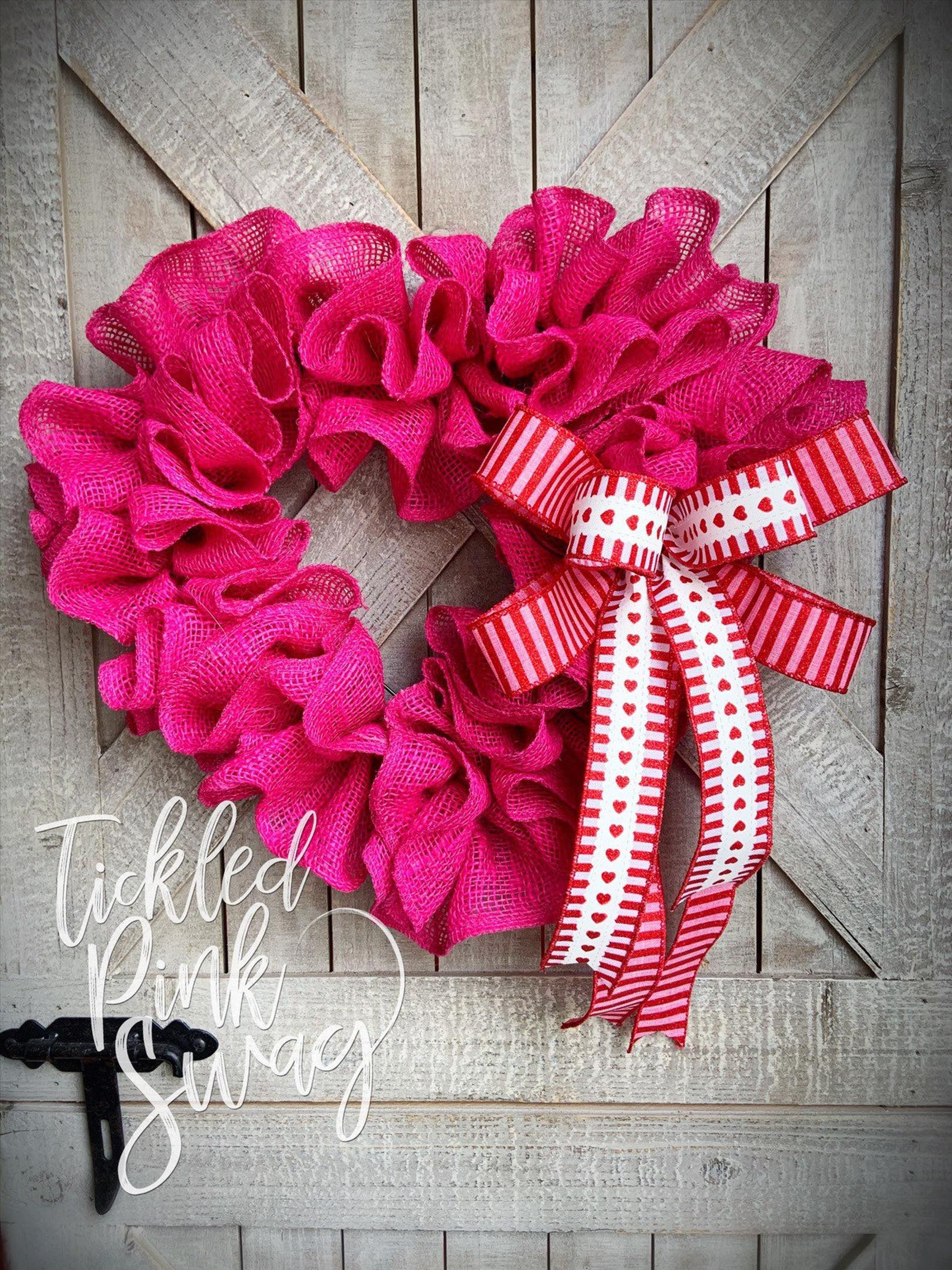 Pink heart-shaped wreath with burlap