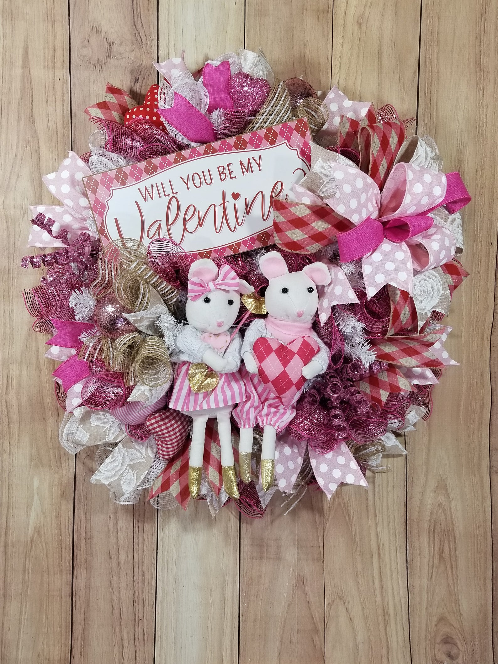 Cute pink decorative knitted Valentine's wreaths