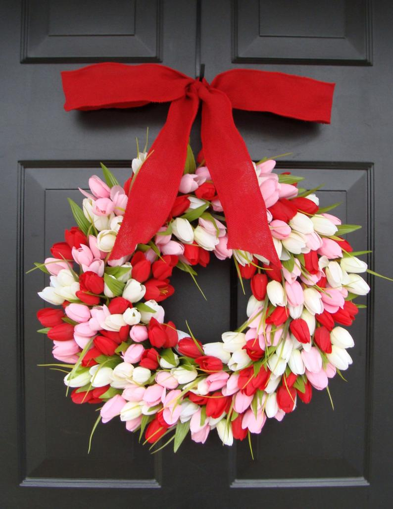 White, red and pink Valentine's Day wreaths for the front door - white, pink and red tulip wreaths with ribbons