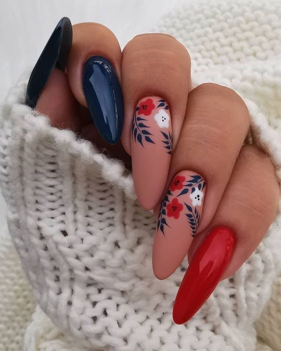 Acrylic floral nails with blue, red and neutral shades