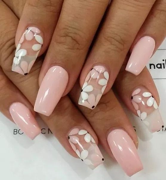 Light pink flower nails in the form of an acrylic coffin