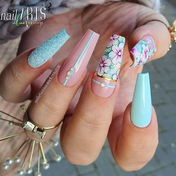 Pink and blue floral nail designs in the shape of acrylic coffins