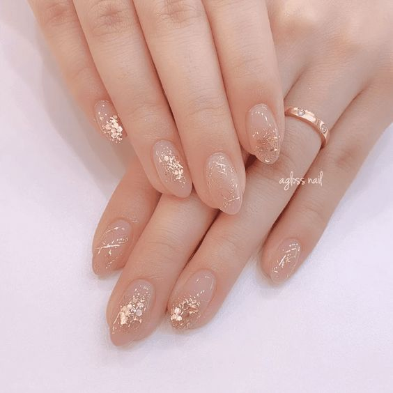 Short acrylic almond wedding nails with gold foil