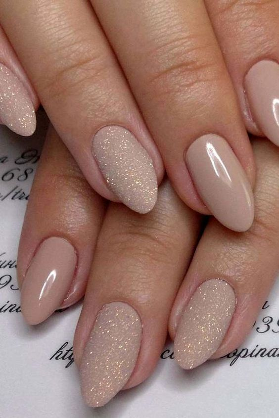 Elegant nude wedding nails with glitter