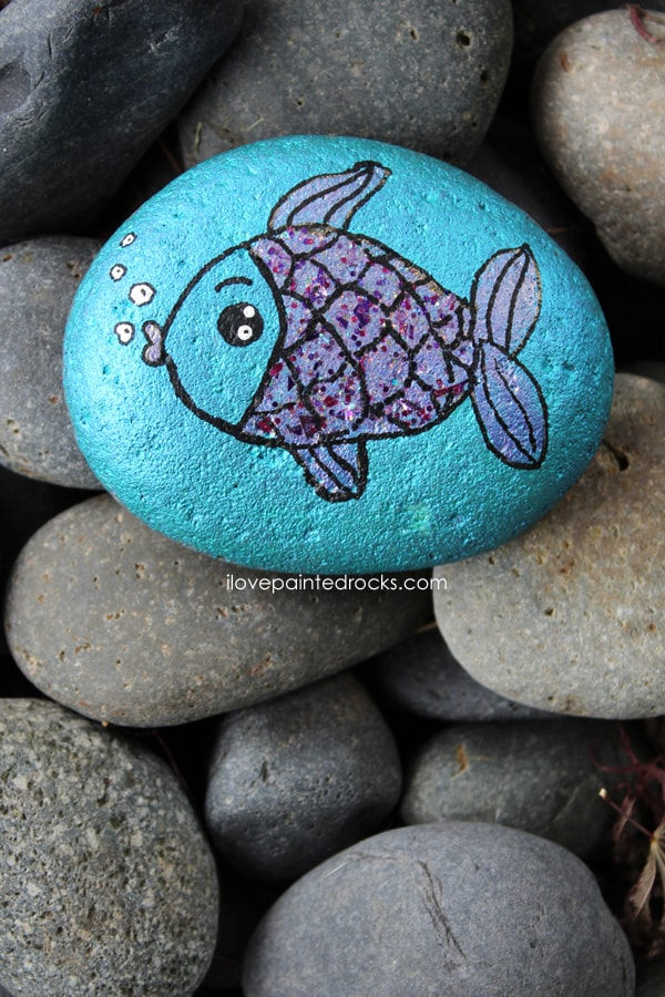 Fish rock painted blue