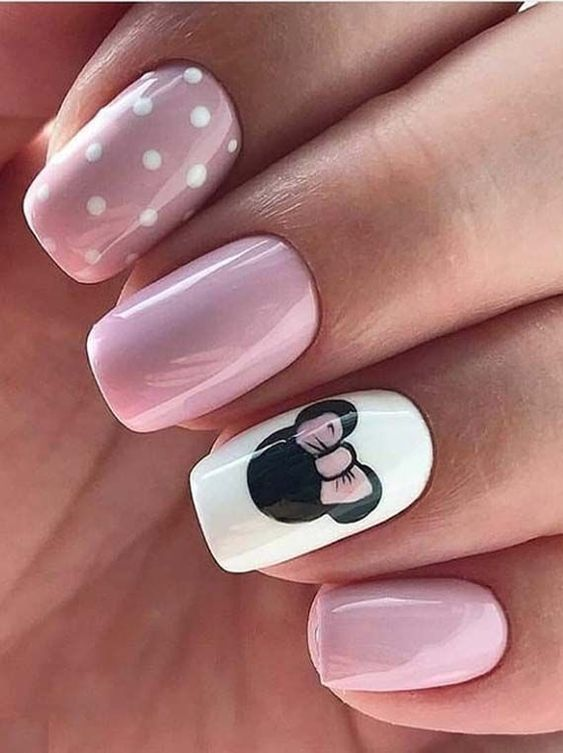 Pink Disney nails with Minnie Mouse