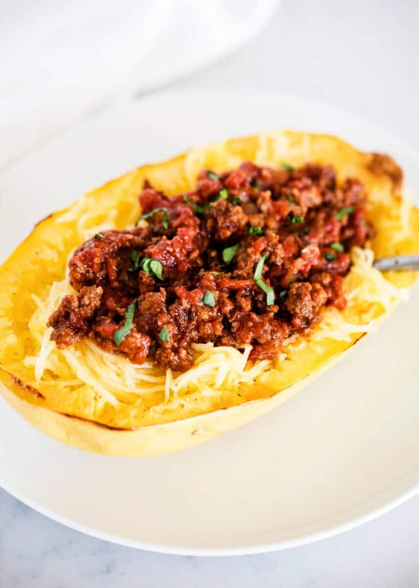 Spaghetti zucchini with meat sauce on the plate