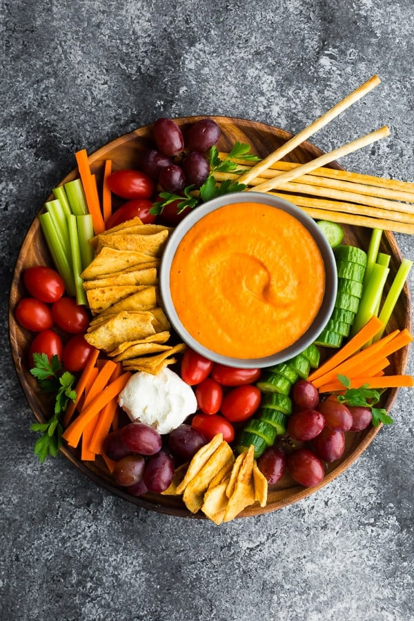 Top view of toasted red pepper hummus in appetizer tray