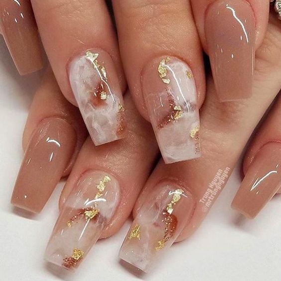 White and pink marble nails with gold leaf
